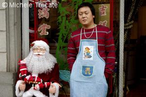 Babbo Natale con negoziante cinese